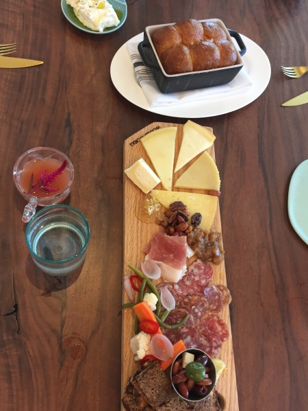 Meat and cheese board, with brioche bread and ricotta cheese